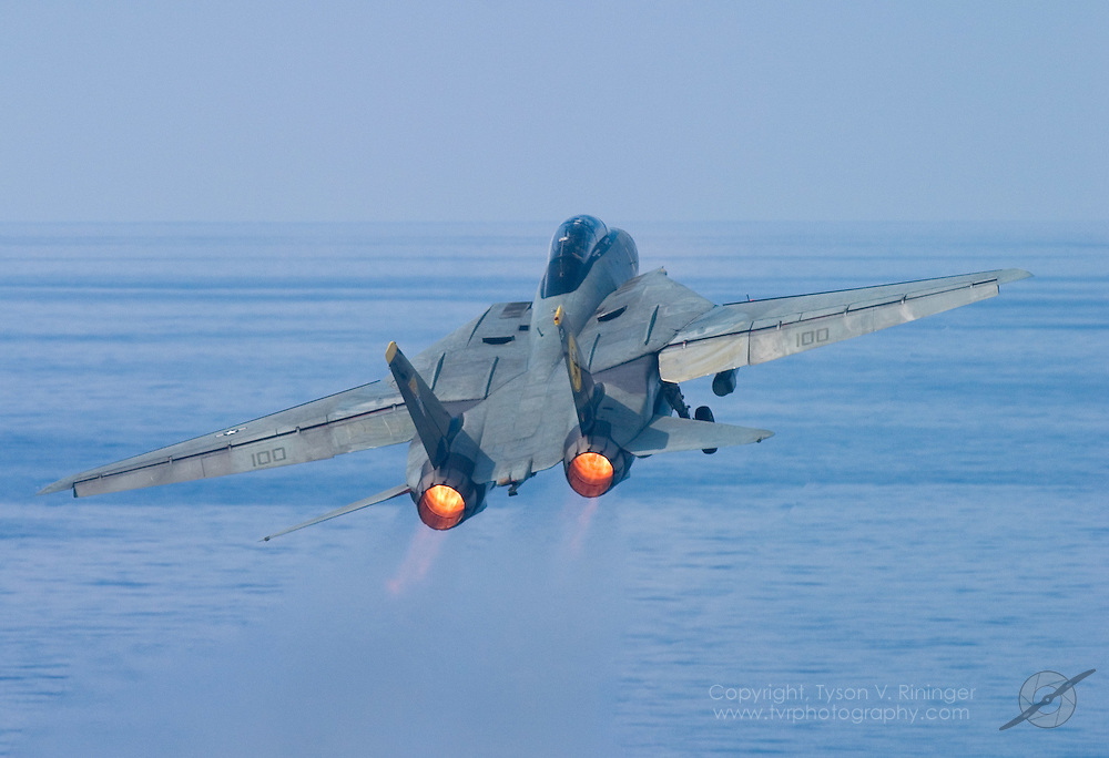 AJ100, an F-14 Tomcat from VF-31 'Tomcatters', launches off the deck of the USS Theodore Roosevelt CVN-71 during sea trials prior to their 2005 Mediterranean deployment. This would be the final cruise for the F-14 Tomcat and the last time it would ever see combat.