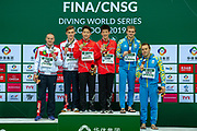 Men's Syncronised 3m dive podium presentation with Gold Medal for Zongyuan Wang of China and Luxian Wu of China, Silver Medal for Evgenii Kuznetsov of Russia and Nikita Shleikher of Russia, Bronze Medal for Oleg Kolodiy of the Ukraine and Oleksandr Gorshkovozov of the Ukraine during the FINA/CNSG Diving World Series 2019 at London Aquatics Centre, London, United Kingdom on 17 May 2019.