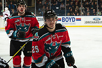 KELOWNA, CANADA - NOVEMBER 21:  Kyle Crosbie #25 of the Kelowna Rockets skates to the bench to celebrate a first period goal against the Regina Pats on November 21, 2018 at Prospera Place in Kelowna, British Columbia, Canada.  (Photo by Marissa Baecker/Shoot the Breeze)