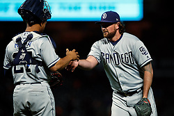 SAN FRANCISCO, CA - SEPTEMBER 24: Kirby Yates #39 of the San Diego Padres celebrates with Francisco Mejia #27 after the game against the San Francisco Giants at AT&T Park on September 24, 2018 in San Francisco, California. The San Diego Padres defeated the San Francisco Giants 5-0. (Photo by Jason O. Watson/Getty Images) *** Local Caption *** Kirby Yates; Francisco Mejia