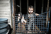 Bambini all'interno di un convettillo nel quartiere de La Boca a Buenos Aires, 4 marzo 2011.<br /> Foto Christian Mantuano / OneShot