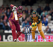 Chris Gayle four off David Hussey during the ICC World Twenty20 Cup match between Australia and West Indies at the Oval. Photo © Graham Morris (Tel: +44(0)20 8969 4192 Email: sales@cricketpix.com)