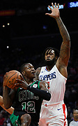 Boston Celtics guard Terry Rozier #12 drives the lane against LA Clippers center DeAndre Jordan #6 in the 2nd half. The Los Angeles Clippers were defeated by the Boston Celtics 113-102 in a regular season NBA matchup in Los Angeles, CA 1/025/2018 (Photo by John McCoy, Los Angeles Daily News/SCNG)