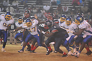 Oxford High's Xavier Pegues (44), Oxford High's Jarquis Adams (7), and Oxford High's Kevin Whitney (47) vs. Clarksdale High in Clarksdale, Miss. on Friday, November 2, 2012. Oxford won.