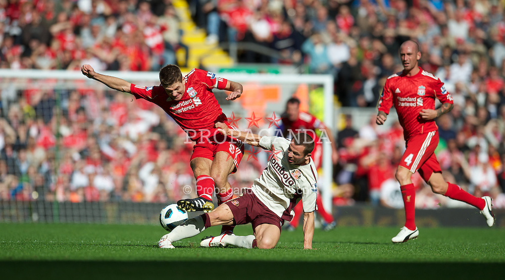 LIVERPOOL, ENGLAND - Saturday, September 25, 2010: Liverpool's captain Steven Gerrard MBE and Sunderland's Phillip Bardsley during the Premiership match at Anfield. (Photo by David Rawcliffe/Propaganda)