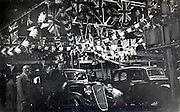 end of the assembly line at a English car factory 1930s