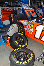 ROSEVILLE, CA - OCTOBER 13: A crew member changes tires on the  #17 MMI Services/Ron's Rear Ends Chevrolet, driven by David Mayhew (not pictured) during practice for the NASCAR K&N Pro Series West Toyota/NAPA 150 at the All American Speedway on October 13, 2012 in Roseville, California. (Photo by Jason O. Watson/Getty Images for NASCAR) *** Local Caption ***