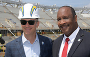 Apr 15, 2019; Inglewood, CA, USA; Los Angeles Chargers president of business operations A.G. Spanos (left) poses with Inglewood mayor James Butts aka James T. Butts at the LA Stadium & Entertainment District construction site. The site will be the home of the Chargers and the Los Angeles Rams, Super Bowl LVI in 2022, the College Football National Championship in 2023 and the opening and closing ceremonies of the 2028 Olympic Games.