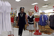 Faith Ehring of Centerville (left,) and LaRashia Simone Edwards of Trotwood during a fashion show at the Elder Beerman store in the Dayton Mall, Saturday, August 14. 2010..