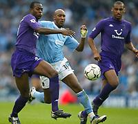 Photo. Aidan Ellis.<br />Manchester City v Tottenham Hotspur.<br />FA Barclaycard Premiership.<br />28/09/2003.<br />City's Nicolas Anelka battles with Spurs Anthony Gardener