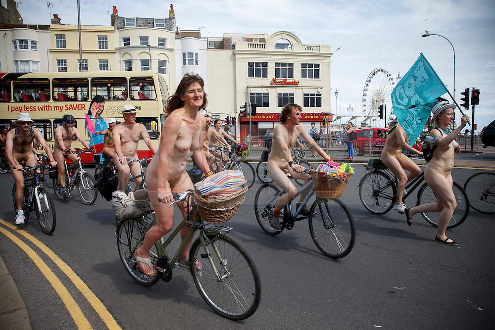 © Licensed to London News Pictures. 08/06/2014. BRIGHTON, UK. Nude protesters cycle through the streets of Brighton on Sunday 8 June 2014 as part of the World Naked Bike Ride, which aims to raise awareness of cyclists on the roads and in the traffic. Photo credit : Tolga Akmen/LNP