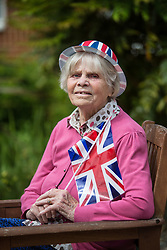 @Licensed to London News Pictures 08/05/2020. Maidstone, UK.. Former WAAF Joan Edwards, 96,  waits patiently for the bugler to sound to pay tribute to VE75 Day at Queen Elizabeth Court in the Royal British Legion village in Aylesford, Kent. RBLI also wanted to use Two Minute Silence to honour the service and sacrifice of the Second World War generation and reflect on the devastating impact Covid-19 has had on so many lives across the world.  Photo credit: Manu Palomeque/LNP
