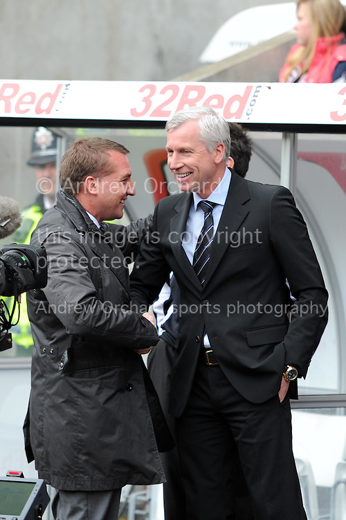 Newcastle Utd manager Alan Pardew greets Swansea manager Brendan Rodgers (l) before k/o. Barclays Premier league,  Swansea city v Newcastle Utd at the Liberty  stadium in Swansea, South Wales on Friday 6th April  2012.  pic by Andrew Orchard, Andrew Orchard sports photography,