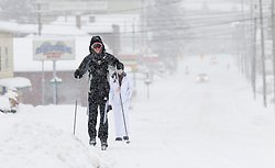 Saturday, Jan. 22, 2016: West Virginia University college students ski on Beechurst Ave. in Morgantown, W.Va. after Winter Storm Jonas ripped through North Central West Virginia and dumped nearly 18 inches of snow. (Photo by Ben Queen)