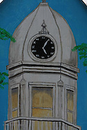 Painting on ornamental birdhouse depicts courthouse clock tower in hometown of Harper Lee, author of To Kill a Mockingbird; Monroeville, Alabama.