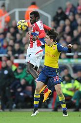 Stoke's Mame Biram Diouf on the ball under pressure from Arsenal's Hector Bellerin - Photo mandatory by-line: Dougie Allward/JMP - Mobile: 07966 386802 - 06/12/2014 - SPORT - Football - Stoke - Britannia Stadium - Stoke City v Arsenal - Barclays Premie League