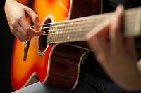 Woman Playing Guitar detail close-up