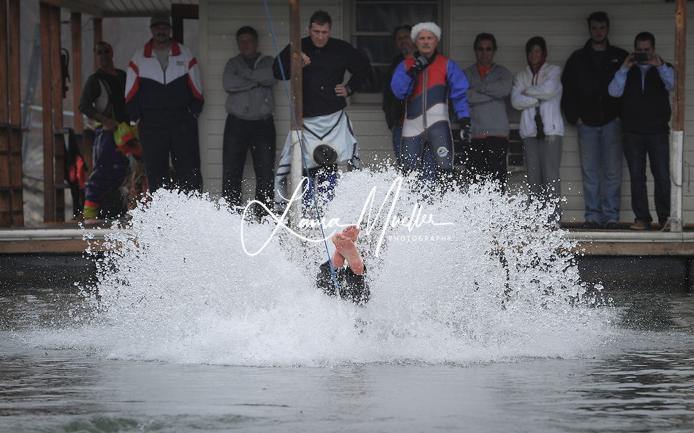 Sherrills Ford, NC - Becky Welch comes up barefeet first before looping around the lake at 35-36 mph. Welch started water skiing about one year ago. It was her first time in the barefoot competition..     The 33rd Annual Lake Norman New Years Day Barefoot Challenge began  just after noon Saturday, despite a morning fog that blanketed the lake. The fog obligingly lifted as they took the towboat on a test run, looping by the Lake Norman Marina. photo © Laura Mueller - www.lauramuellerphotography.com