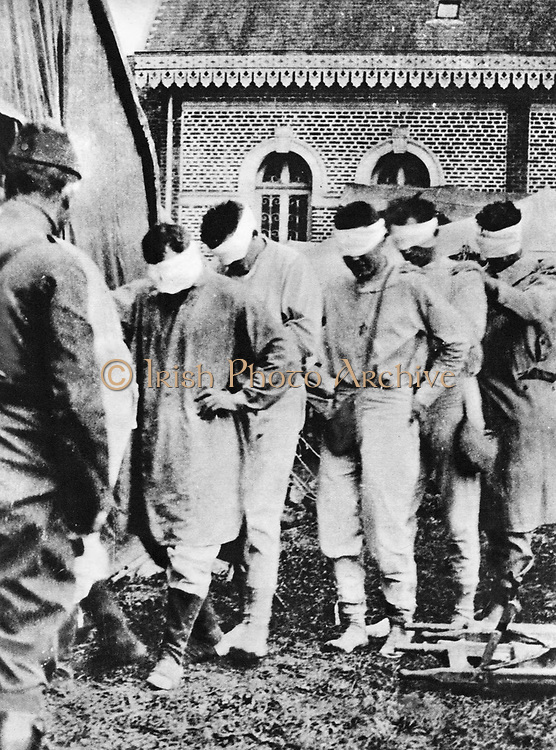 World War I  - American prisoners of war, victims of German gas attacks. Bandaged eyes are not blindfolded but have medical dressings.