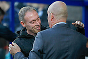 Queens Park Rangers manager Mark Warburton greets Swansea City manager Steve Cooper before the EFL Sky Bet Championship match between Queens Park Rangers and Swansea City at the Kiyan Prince Foundation Stadium, London, England on 21 August 2019.