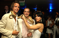 Left to right, CHARLIE GILKES, JAMES AMOS and SEFFI NAVARRO at Boodles on the Beach -  a party to launch jewellers new collection 'Daiquiri' held at Pangaea, 85 Piccadilly, London W1 on 7th June 2005.<br />