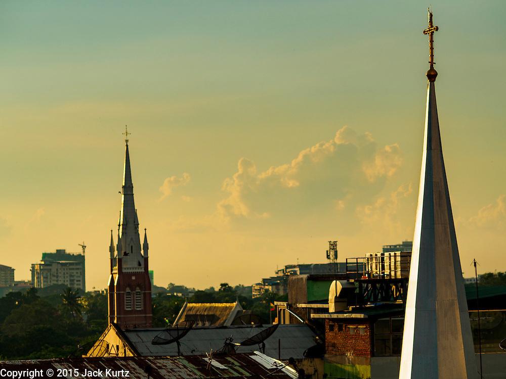20 OCTOBER 2015 - YANGON, MYANMAR:  The spire for St. John's Catholic Church, a colonial era Catholic church, rises over Yangon. PHOTO BY JACK KURTZ