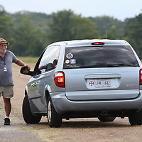 Norris Robbins guides a student as they reverse through one of the courses Saturday