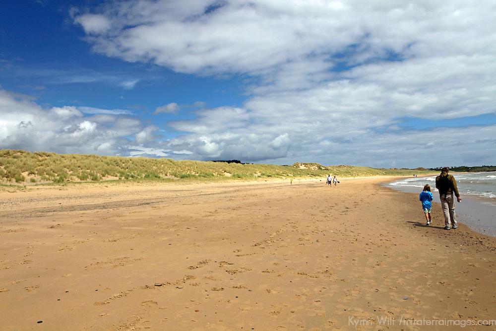 Europe, Ireland, Brittas Bay. Beachcombing at Brittas Bay.