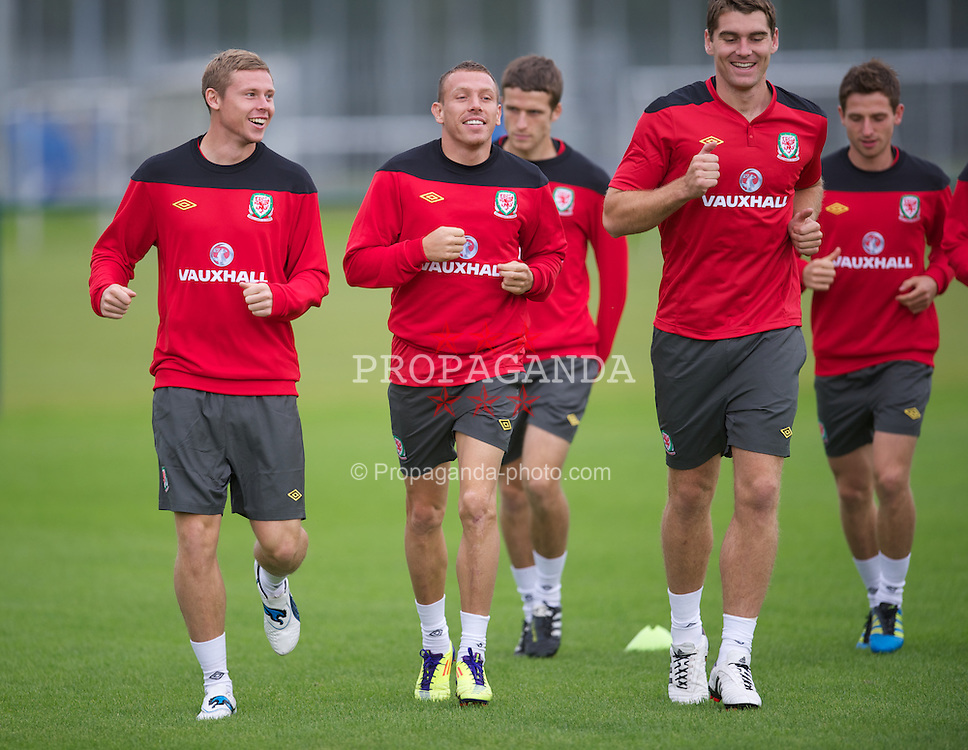 NEWPORT, WALES - Monday, August 29, 2011: Wales' Simon Church, Craig Bellamy and Sam Vokes during a training session at the Glamorgan Sport Park ahead of the UEFA Euro 2012 Qualifying Group G match against Montenegro. (Pic by David Rawcliffe/Propaganda)