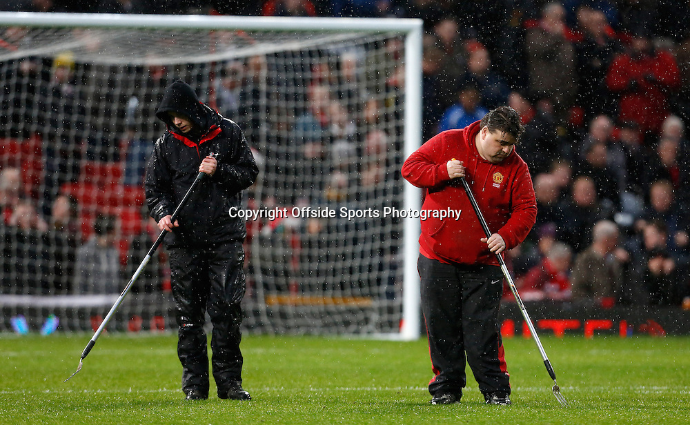 26th December 2012 - Barclays Premier League - Manchester United vs. Newcastle - Ground staff prepare the pitch before kick off - Photo: Paul Thomas / Offside.