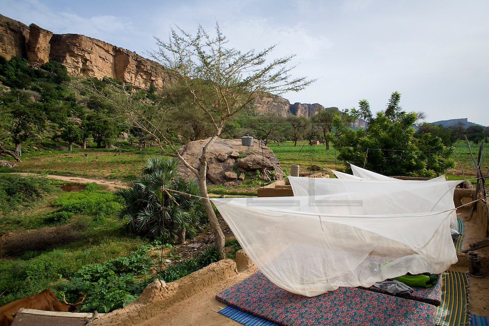 Mosquito nets in the rooftops are the most common place for a tourist to sleep in campments in the Bandiagara Escarpment. The Dogon Country is the most visited part of Mali with tourists visiting its tipical  villages that can be located on the cliff, on the sandy plain or in the rocky plateau