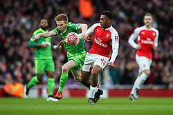 Alex Iwobi of Arsenal tackled by Duncan Watmore of Sunderland - Mandatory byline: Jason Brown/JMP - 07966386802 - 09/01/2016 - FOOTBALL - Emirates Stadium - London, England - Arsenal v Sunderland - The Emirates FA Cup