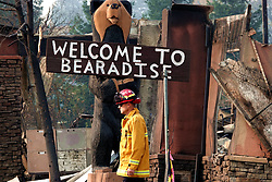 November 19, 2018 - A firefighter walks past houses destroyed by the wildfire in 'Bearadise' Paradise of Butte County, California, the United States, Nov. 18, 2018. The death toll from the massive wildfire in Northern California, dubbed the Camp Fire, has climbed to 77, said authorities on Sunday evening.  wsw) (Credit Image: © Wu Xiaoling/Xinhua via ZUMA Wire)