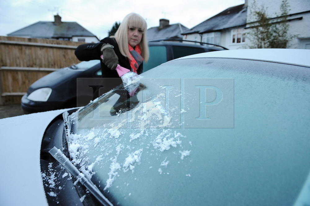 &copy; Licensed to London News Pictures. 19/01/2015<br /> Cleaning ice off the car.<br /> A very cold morning St Pauls Cray,Orpington,Kent. today (19.01.2015)<br /> Weather warning has been issued across most of the uk as temperatures dropped overnight to -11c in parts.<br /> <br /> (Byline:Grant Falvey/LNP)