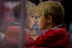 A young capitals fan looks on during the first round NHL playoff game between the Columbus Blue Jackets and Washington Capitals at Capital One Arena in Washington, D.C. on April 21, 2018.