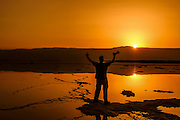 Silhouette of a man appreciating the sunrise Photographed at the Dead Sea Israel