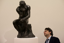 © Licensed to London News Pictures. 12/04/2013. London, UK. A visitor views Auguste Rodin's 'Le Penseur? sculpture with an estimated value of between 8 - 12 million USD for the upcoming New York auctions. Highlights from Sotheby's New York auctions of Impressionist and Modern Art and Contemporary Art will be exhibited to the public from 12-16 April at  Sotheby's London New Bond Street galleries..Photo credit : Peter Kollanyi/LNP