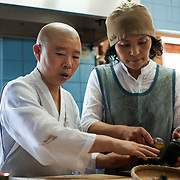 South Korea. Baekyangsa monastry. Buddhist nun Keong Kwan prepares lunch in her well appointed kitchen at the monastry where she lives in South Korea. Almost all of the food that she cooks and prepares is either grown of harvested from her garden and around the monastry or bought locally.<br /> Photo Mark Chilvers