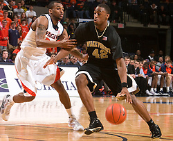 Wake Forest guard L.D. Williams (42) dribbles past Virginia guard Jeff Jones (23).  The Virginia Cavaliers fell to the #13 ranked Wake Forest Demon Deacons 70-60 at the John Paul Jones Arena on the Grounds of the University of Virginia in Charlottesville, VA on February 28, 2009.