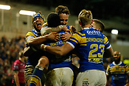 Kallum Watkins (C) of Leeds Rhinos celebrates scoring his teams 3rd Try against Hull FC with team mate Jack Ormondroyd (R)  and Ashton Golding (L) during the Betfred Super League match at Emerald Headingley Stadium, Leeds<br /> Picture by Stephen Gaunt/Focus Images Ltd +447904 833202<br /> 08/03/2018