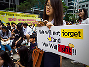 "SEOUL, SOUTH KOREA: A South Korean woman with a placard during the Wednesday protest at the Japanese embassy in Seoul. The Wednesday protests have been taking place since January 1992. Protesters want the Japanese government to apologize for the forced sexual enslavement of up to 400,000 Asian women during World War II. The women, euphemistically called ""Comfort Women"" were drawn from territories Japan conquered during the war and many came from Korea, which was a Japanese colony in the years before and during the war. The ""comfort women"" issue is still a source of anger of many people in northeast Asian areas like South Korea, Manchuria and some parts of China.   PHOTO BY JACK KURTZ   <br /> Wednesday Demonstration demanding Japan to redress the Comfort Women problems"