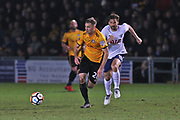 Newport  Mickey Demetriou (28) on the ball during the The FA Cup 4th round match between Newport County and Tottenham Hotspur at Rodney Parade, Newport, Wales on 27 January 2018. Photo by Gary Learmonth.