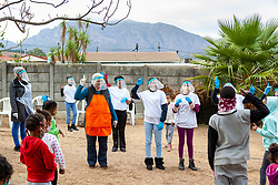"""Local ladies and youth dance at a """"Safe Zone"""" in Vanwyk'svlei, Wellington, Western Cape, South Africa.(Picture: JULIAN GOLDSWAIN)"""