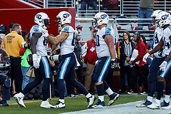 SANTA CLARA, CA - DECEMBER 17: Tight end Delanie Walker #82 of the Tennessee Titans is congratulated by teammates after scoring a touchdown against the San Francisco 49ers during the second quarter at Levi's Stadium on December 17, 2017 in Santa Clara, California.  (Photo by Jason O. Watson/Getty Images) *** Local Caption *** Delanie Walker