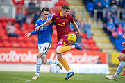 Jake Hastie (#32) of Motherwell FC attempts to flick the ball past Scott Tanser (#3) of St Johnstone FC during the Ladbrokes Scottish Premiership match between St Johnstone and Motherwell at McDiarmid Stadium, Perth, Scotland on 11 May 2019.