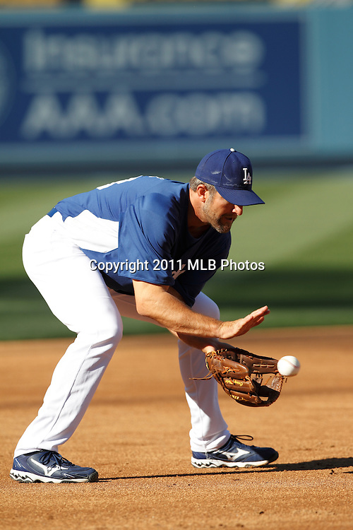 LOS ANGELES, CA - APRIL 15:  Third baseman Casey Blake #23 of the Los Angeles Dodgers catches a ground ball while warming up before the game between the St. Louis Cardinals and the Los Angeles Dodgers on Friday April 15, 2011 at Dodger Stadium in Los Angeles, California. (Photo by Paul Spinelli/MLB Photos via Getty Images) *** Local Caption *** Casey Blake