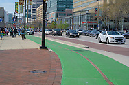 Baltimore, MD, USA --April 13, 2019-- A bike lane on E Pratt Street is painted green in the busy area around Baltimore's inner harbor.