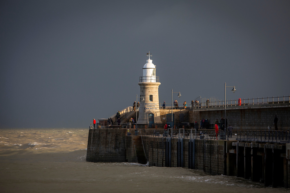 Folkestone Harbour Arm pier on a dark stormy day re-opened in 2015 as a public space in Folkestone, Kent, England, United Kingdom.  The Lighthouse has been opened as a Champagne Bar and the pier exhibits two Folkestone Artworks.  (photo by Andrew Aitchison / In pictures via Getty Images)