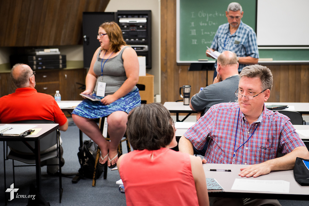 The Rev. Dr. Jon Vieker (left, seated), senior assistant to the president of The Lutheran Church–Missouri Synod, leads a hymn writing workshop at the 2014 Institute on Liturgy, Preaching and Church Music on Tuesday, July 29, 2014, at Concordia University, Nebraska, in Seward, Neb. LCMS Communications/Erik M. Lunsford