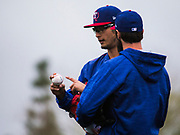 Texas Rangers starting pitcher Yu Darvish (11) discusses grip with starting pitcher Cole Hamels (35) during a spring training workout at the team's training facility on Sunday, February 19, 2017 in Surprise, Arizona. (Ashley Landis/The Dallas Morning News)